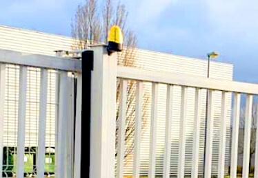 Réparation de portail électrique battant industriel et porte de garage en Alsace