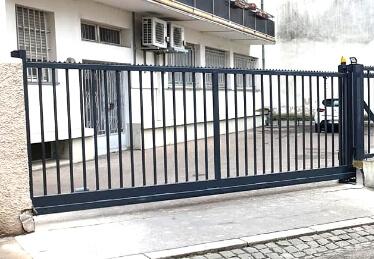 Réparation de portail électrique coulissant industriel et porte de garage en Alsace